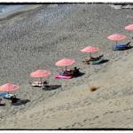Ombrelloni Rosa sulla spiaggia